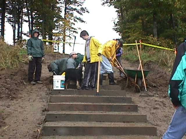 Scouts from Troop 676 help to build a set of stairs